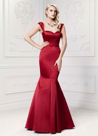 Channel Old Hollywood glamour in this sensational long satin trumpet gown!  Cap sleeve bodice features intricate topstitching detail to highlight custom flattering seam accents.  Sweetheart neckline and dramatic trumpet skirt create beautiful and stunning focal points.  Sizes 0-14. Available in Apple.  Fully lined. Back zip. Dry clean only. To protect your dress, try our Non Woven Garment Bag.