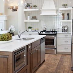 love the floors, cabinets, open shelves, and darker island cabinets