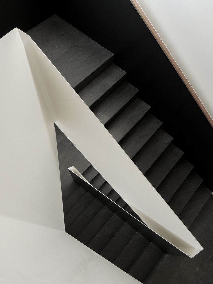 Sharply detailed stair in black and white.