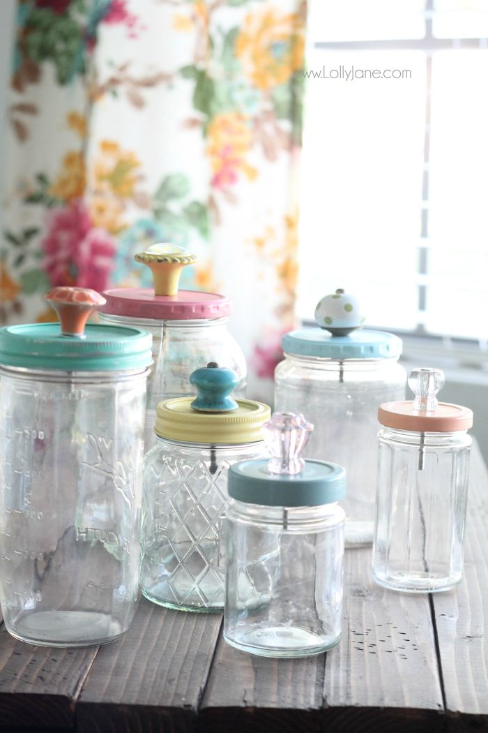 Mason Jar Canisters with Glass Knobs Created by:  Lolly Jane I know that we do a ton of canning in Mason Jars…but now it is so quick and easy to make them into much much more like these beautiful Canisters with Glass Knobs and colored lids.  Come and see how the girls over at Lolly Jane transform an average Mason Jar into a beauty with a drill and a screw on crystal knob.  EZ PZ!!!