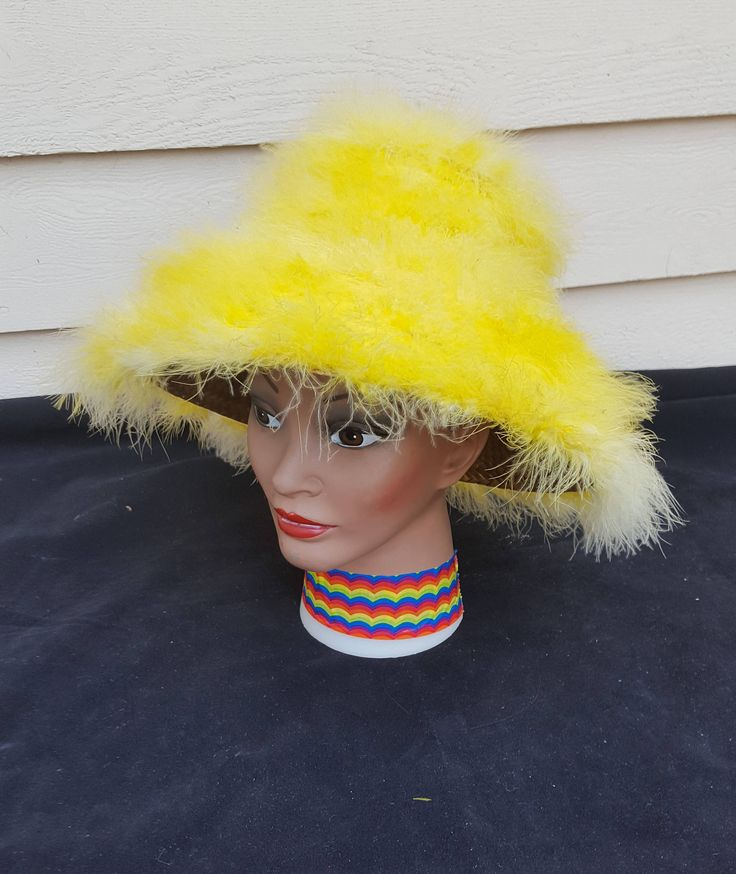 1960's Yellow Feather Couture Beach Hat by LesliesCurios on Etsy https://www.etsy.com/listing/554056031/1960s-yellow-feather-couture-beach-hat
