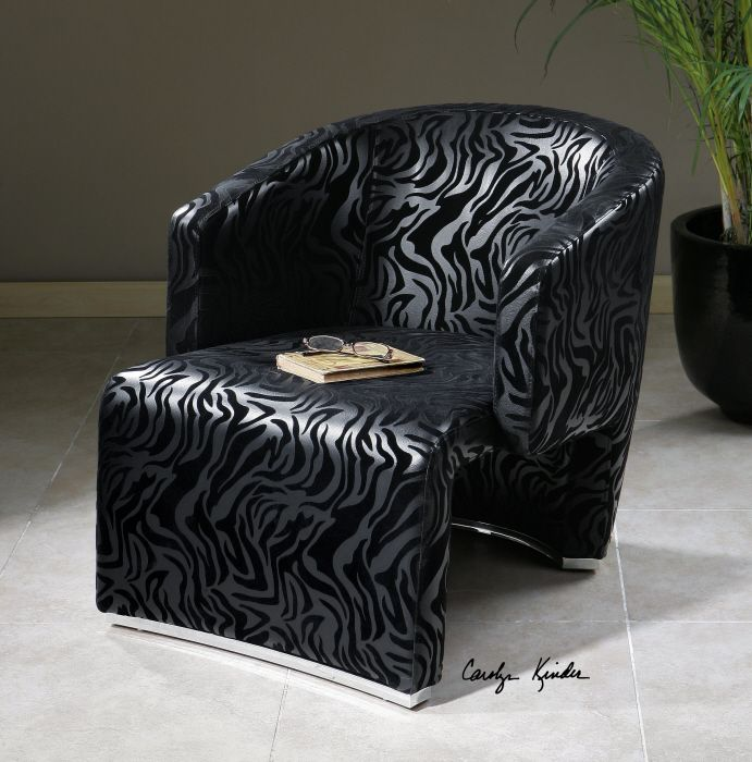 Uttermost Yareli accent chair. Wrap-around style frame in embossed, black zebra with chrome metal accents at the base of front and back.