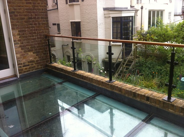 Diomet Glass Balustrade System With Iroko Timber Handrail