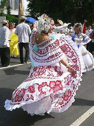 A dance in the streets with the polleras (traditional dresses) of Panama at Carnaval. (La Pollera Montuna)