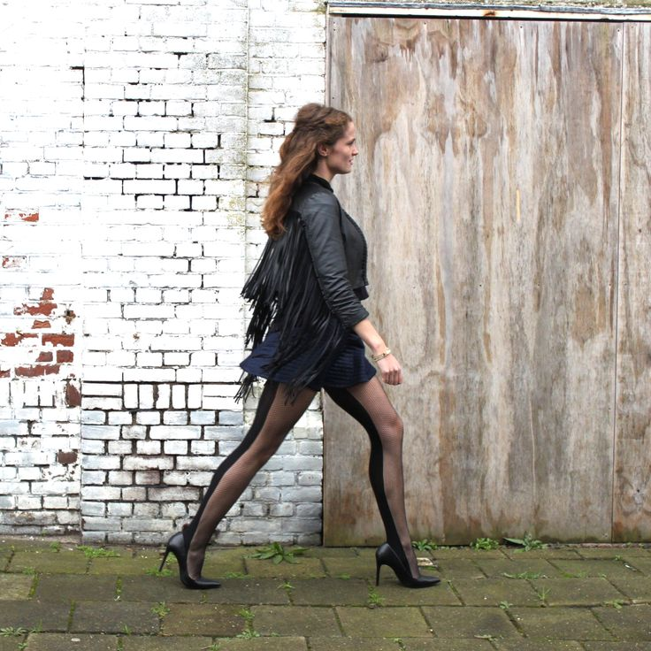 Add a turtle neck, an A-line skirt and some fringes to your hosiery - Fishnet Tights