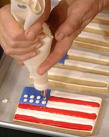 This simple sugar cookie, decorated with royal icing in red, white, and blue, makes a perfect patriotic treat. To achieve flawless flag stripes, use plastic squeeze bottles to flood the cookies with royal icing. l #4thofJuly