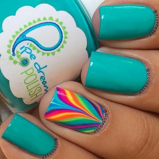 Bright teal nails, accent rainbow nail