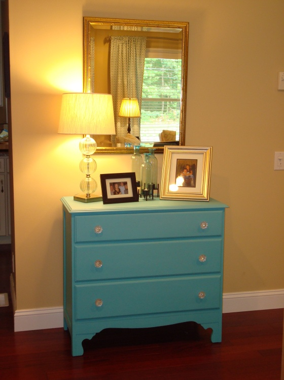 old dresser painted teal with glass knobs