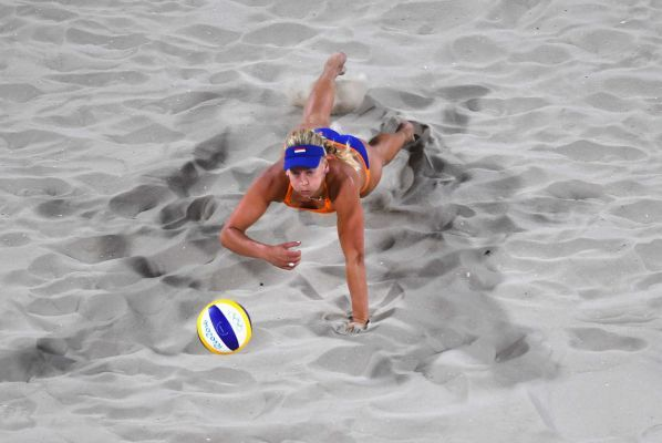 Marleen van Iersel of the Netherlands dives for the ball during the Women's Beach Volleyball preliminary round Pool F match against Olaya Perez Pazo and Norisbeth Agudo of Venezuela on Day 1 of the Rio 2016 Olympic Games at the Beach Volleyball Arena on August 6, 2016 in Rio de Janeiro, Brazil.