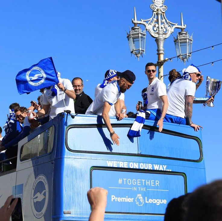 The Albion promotion parade along Brighton & Hove seafront had a fantastic atmosphere; supporters cheered blasted horns waved the blue and white flags and marched alongside the team to Hove Lawns. #Together