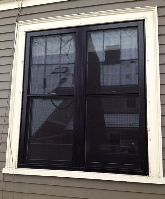 DLM Remodeling Contractors just finished installing some Harvey Vinyl Classic Replacement Windows in Wellesley, MA. The exterior of the windows are in black. Factory painted and double hung windows.