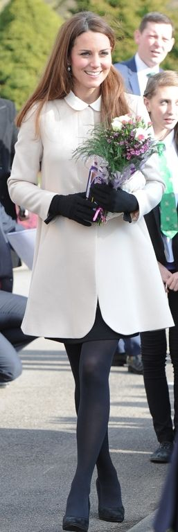 The Duchess of Cambridge was wearing a contrast collar shift dress by Topshop and a cream collarless coat by Goat.