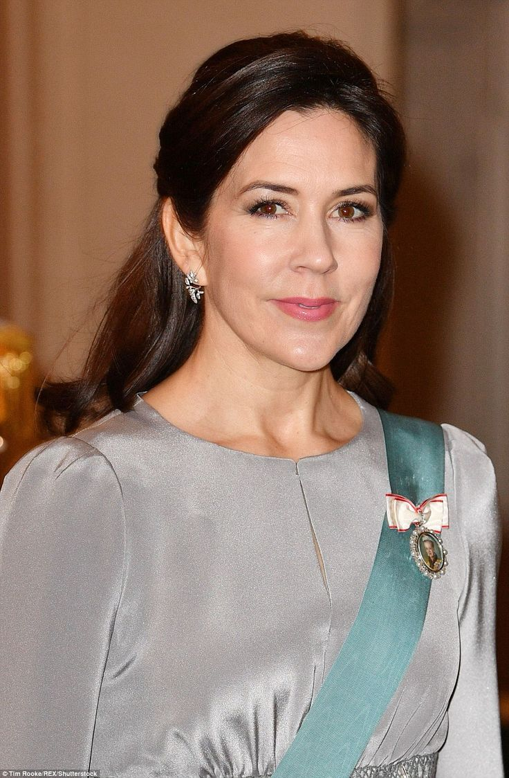 Elegant as always, Crown Princess Mary steps out with her signature natural make-up, paired with a beautiful smile