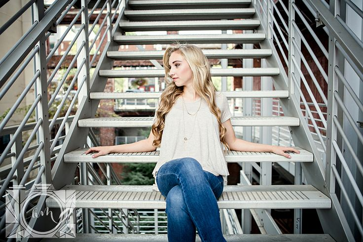 Sitting on stairs senior pictures in downtown knoxville by Amanda May Photos