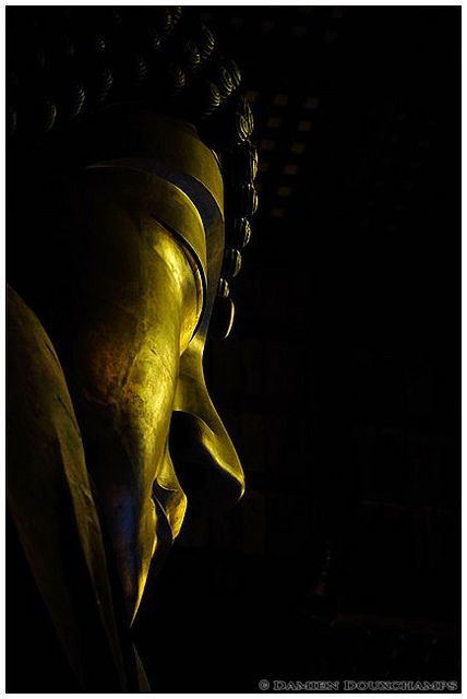 The face of the Great Buddha in Todai-ji temple, Nara, Japan
