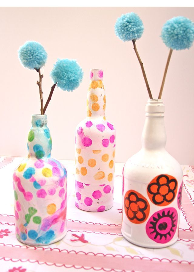 Wine Bottle Vases Decoupaged With Tissue Paper.... great little decorative touch to a young teen's room and if they help you make it (Even Better)