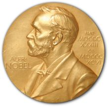 A golden medallion with an embossed image of Alfred Nobel facing left in profile. Noble Peace Prize created.