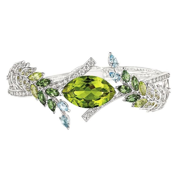Chanel's Les Brins de Printemps bracelet from the Les Bles (the wheat) collection, has a 5.7ct peridot surrounded by sheaves of wheat (POA). Discover more from the birthstone of August: http://www.thejewelleryeditor.com/jewellery/peridot-the-fascinating-story-behind-augusts-birthstone/ #jewelry #fashion