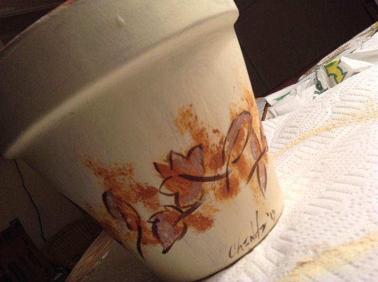 Fall leaves on a terra cotta pot, fill with seeds and small paper sack with potting soil for spring planting...