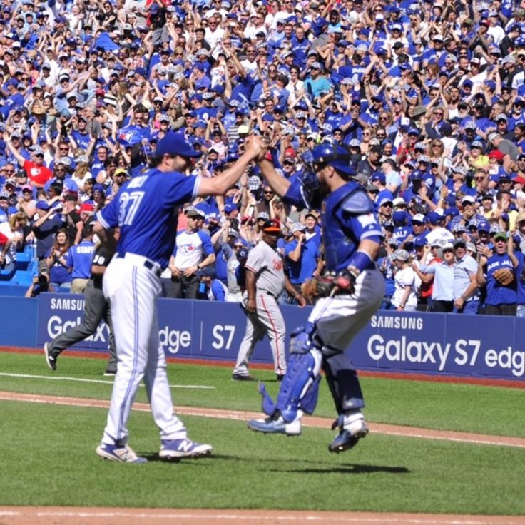 Jason Grilli and Russell Martin celebrate Grilli's first save as a Blue Jay…