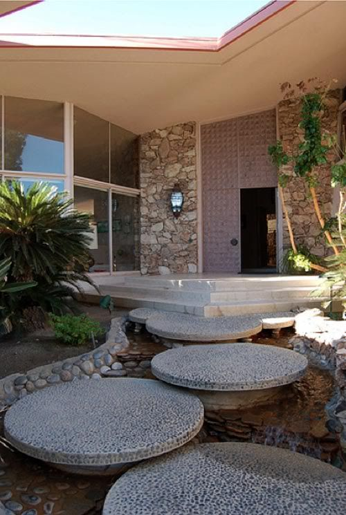 Palm Springs home designed by William Krisel and built by Robert Alexander for his wife Helene in the early 1960s. Elvis & Priscilla Presley spent their honeymoon here. The stepping stones float over a recirculating stream/waterfall.
