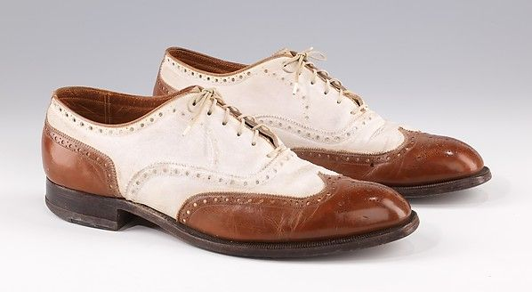 Shoes - MMA Manufacturer: Hill & Novis Date: 1935–45 Culture: American Medium: leather Sportswear provided the most fertile ground for innovation, and some of the more extreme men's fashions, including plus-fours and oxford bags, are now icons of the period.  This pair of classic spectator shoes combines all the quintessential features: white leather with black or brown wing tip and foxing, fully pinked and perforated at the edges, medallion tip, and an oxford  cut