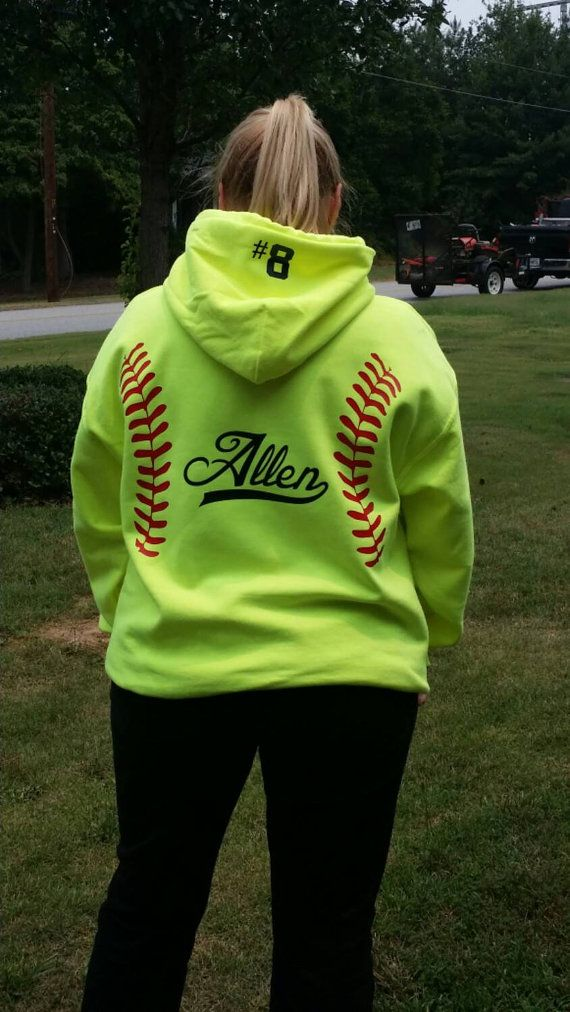 These are our Adult Unisex Softball Hoodies that we have added red REGULAR or GLITTERED vinyl to. In the center we can add a large monogram, team name, players name and/or number. THIS WILL BE IN DONE IN RED unless you ask for a different color. Some pictures shown are in black, we can also do royal or navy. Some pictures show the GLITTERED vinyl and some show the REGULAR vinyl. You can choose this finish in the drop down menu. The glitter sparkles! It might not show well in pictures, but in…