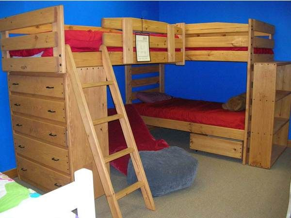 Kid-tough solid wood triple lindy bunk beds with built-in dresser. Custom built by hand. You choose the best finish and options for your room.