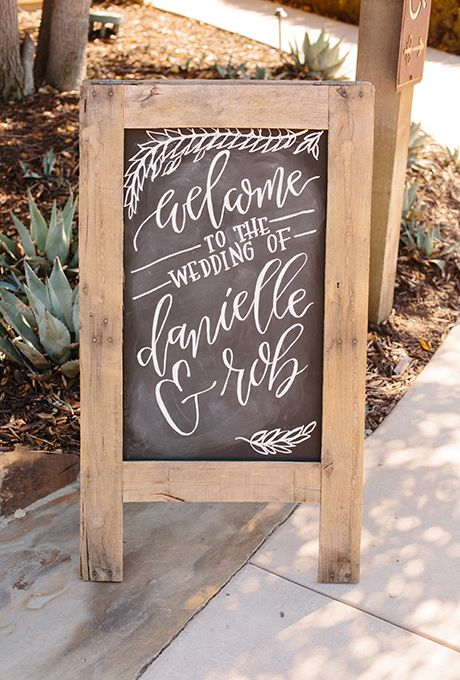 Brides.com: . Create a warm welcome with this hand-calligraphed chalkboard sign — a simple (and pretty!) way to direct your guests to the ceremony space.