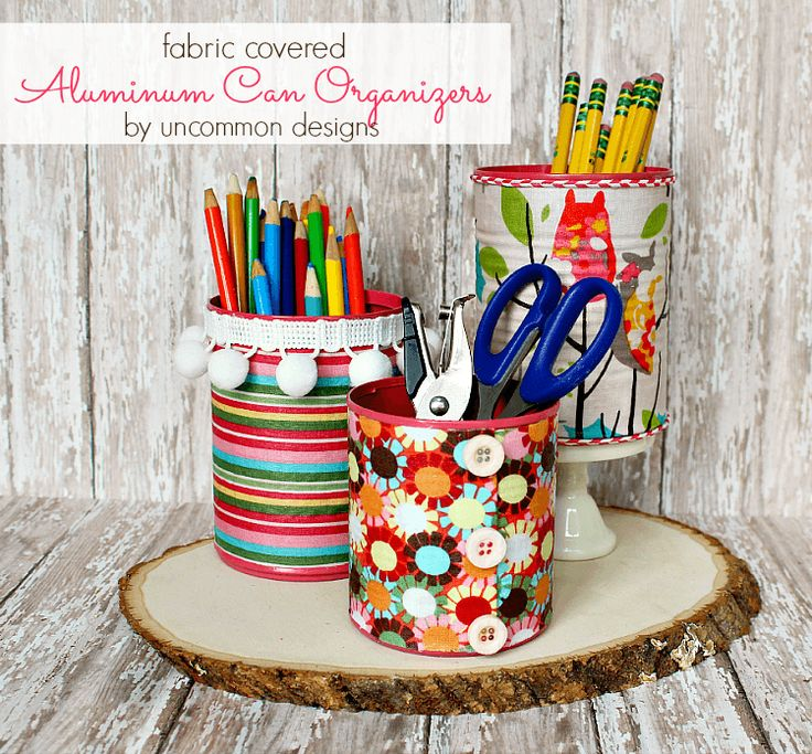 Create these fabric covered aluminum can organizers inspired by All You Magazine. Simple 3 steps and budget friendly using Mod Podge.