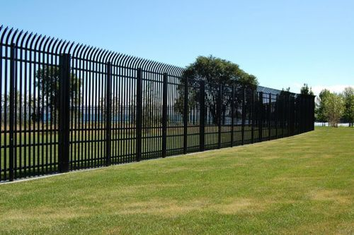 Here is a great security fence. Cement wall will broken bottles on top.