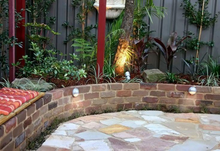 Cottage Style Courtyard Garden. Recycled Sandstock Bricks, Garden Lighting, Arbour, Sandstone Flagging Crazy Paving, Tropical Garden Planting. Small Courtyard Garden Design Sydney. Landscape Gardeners Sydney