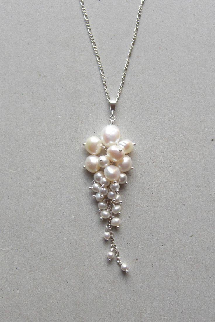 """Signature cluster Freshwater pearl and crystalline pearl pendant set in Fine Silver (99.9% Pure Silver). Looks great with a sweetheart neckline. - Pendant measures approx. 2 1/4"""". - Sterling Silver ch"""