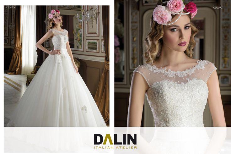 CIGNO_Ad una sposa delicata ed elegante si ispira l'abito sontuoso in tulle ricamato.