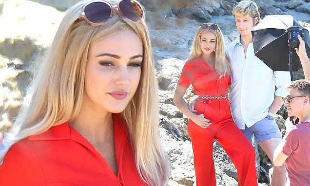 Slipping her lithe frame into a fitted red jumpsuit, the 29-year-old actress showed off her incredible figure as she cosied up to on-screen husband,Lorne Macfadyen.