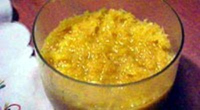 Cocada amarela, yellow coconut pudding made with sugar, grated coconut, egg yolks, and ground cinnamon, a dessert in both Mozambique and Angola. It is very different from what is known as cocada in Brazil.