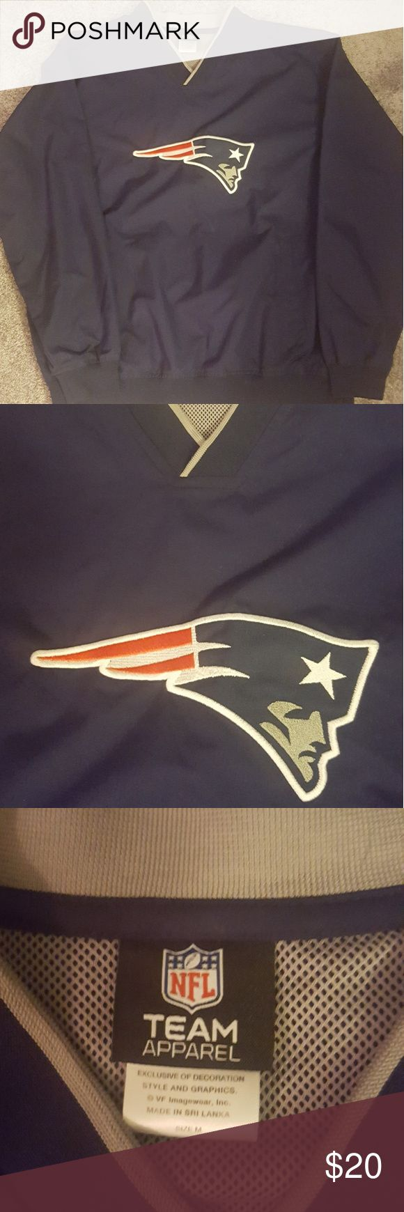 New England Patriots Pull-over Jacket Authentic NFL Gear (this is not Majestic, just wasnt another option) Pull over, slick style, v-neck jacket. Water resistant style material. New England Patriots apparel.  Great on a rainy day or with warm ups.  Worn only a couple times.  Size M (generous fit). Majestic Tops Sweatshirts & Hoodies