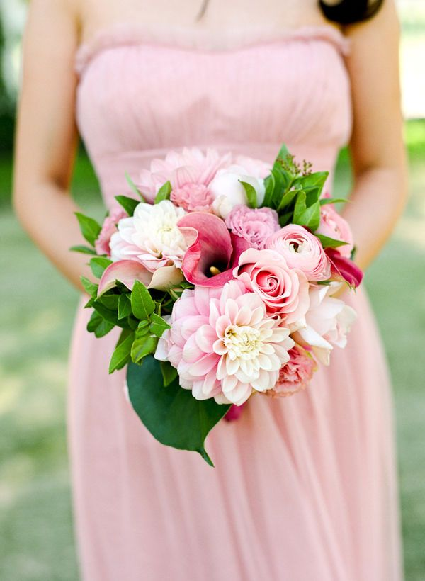 7. I love all of the flowers in this pink bouquet...even love the shade of pink that the bridesmaid is wearing...this is very unusual for me :)