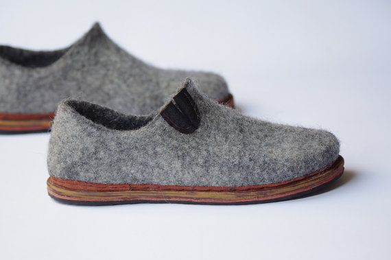 These minimalist style felt shoes are handmade from natural uncolored wool, they are hard felted, comfortable to wear, light weight and of course warm! To produce wool shoes we use natural high quality wool, warm water, olive soap and hand work.  These woman shoes could be warm during spring, summer and autumn when it is dry outside. Because of special wool features with these shoes your feet wont overheat an hot summer day and wont get cold an late autumn season.  Sole is made by hands to…