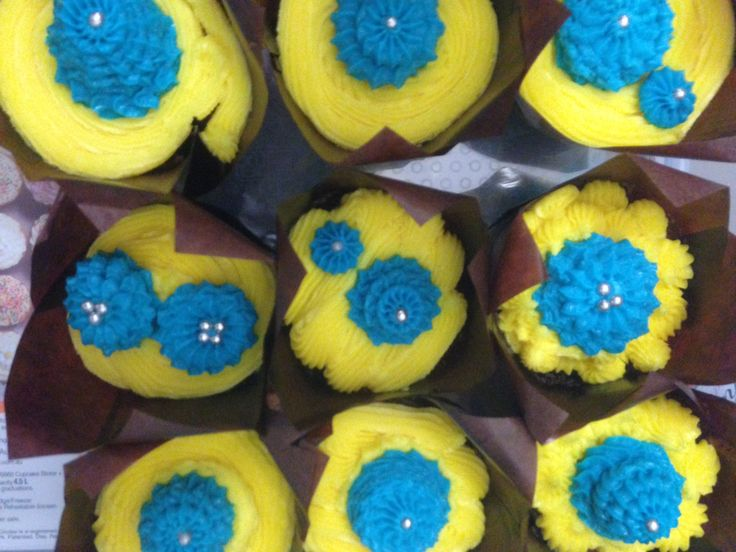 Minion themed cup cakes.  First time making a giant batch.