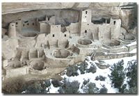 View of Cliff Palace with snow at the base of the alcove- Mesa Verde National Park, Colorado