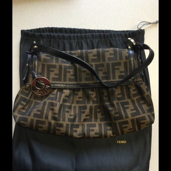 Authentic Fendi purse Fendi purse 12 x 8.  In great condition. Comes with dust bag. The matching wallet is in my closet too. FENDI Bags Satchels