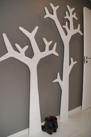 DIY wood tree silhouettes to hang pictures of  our parents and grandparents wedding pictures on.