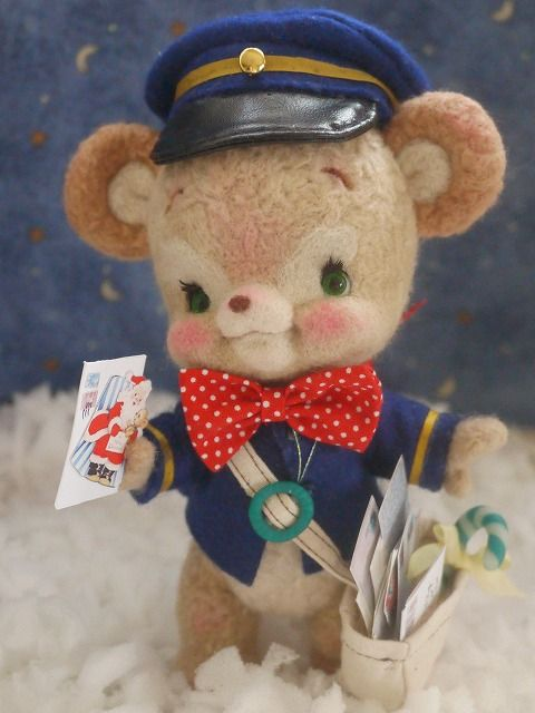 Needle felted mail bear. This is too cute! His clothes are utterly flawless and so adorable.