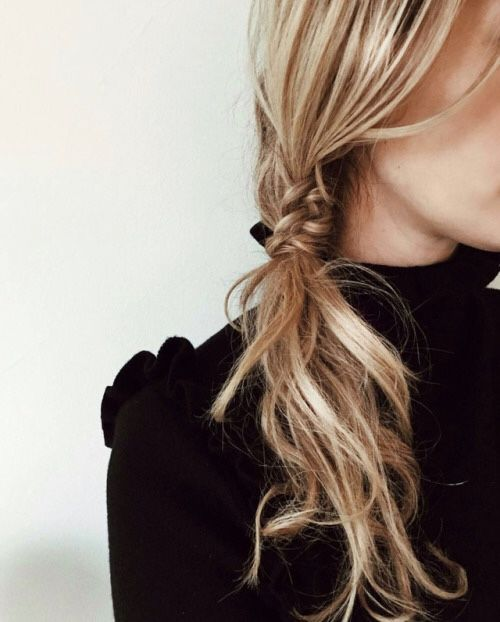 Loose fishtail meets messy ponytail