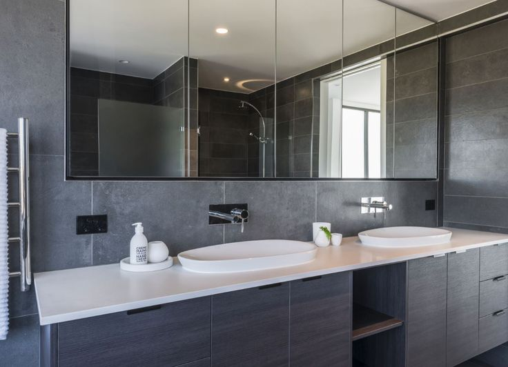 essastone in White Concrete adds a layer of luxury to this bathroom
