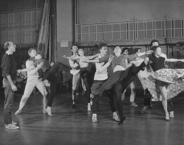 """Jerome Robbins (at left) rehearsing cast for """"Dance at the Gym"""" number in West Side Story. NYPL Digital Images Collection"""