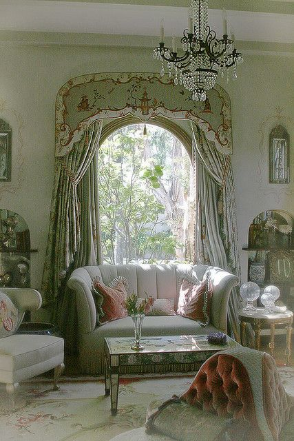 The green is a nice touch in this shabby, Victorian living room.