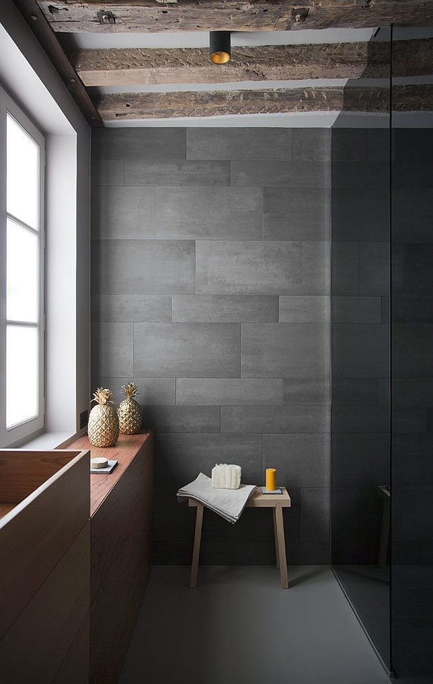 marcja // Too dark a color palette overall, but I like the tile pattern of two different size tiles and the texture of the porcelain tiles. The wood contrast of the sink is also well-handled.