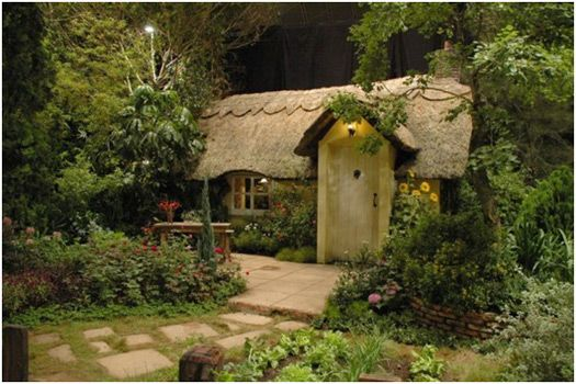 fairy tale cottage -- wouldn't this be the most amazing playhouse?